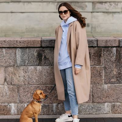 Our brand manager Indre wearing KJŪTALAS hoodie in pastel blue 💙🍁 perfect choice for long walks in the city after Sunday brunch ☕️  #bykarolinameschino